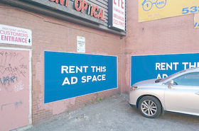 [Image: Outdoor ad space infront of an optical shop]
