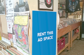 [Image: Ad space in a books and cd strore]