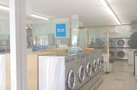 [Image: Indoor Ad Space at a Laundromat / Convenience Store]