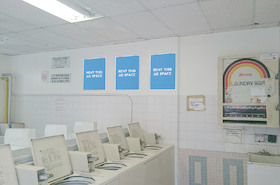 [Image: Indoor ad space in coin laundry]