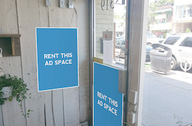 [Image: Indoor ad space in a flower shop]