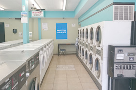 [Image: Indoor ad space in a coin laundry]