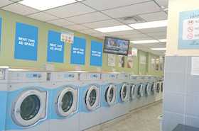 [Image: Indoor ad space at Downtown Laundromat]