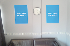 [Image: Ad space for a poster in a tanning studio]
