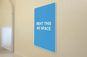 [Image: Ad space in a washroom]