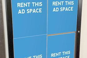 [Image: Indoor ad space on a large poster frame]