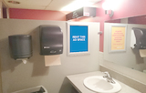 [Image: Indoor ad space in a bar and grill washroom]