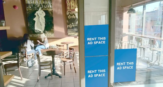 [Image: Ad space outside a coffee shop]