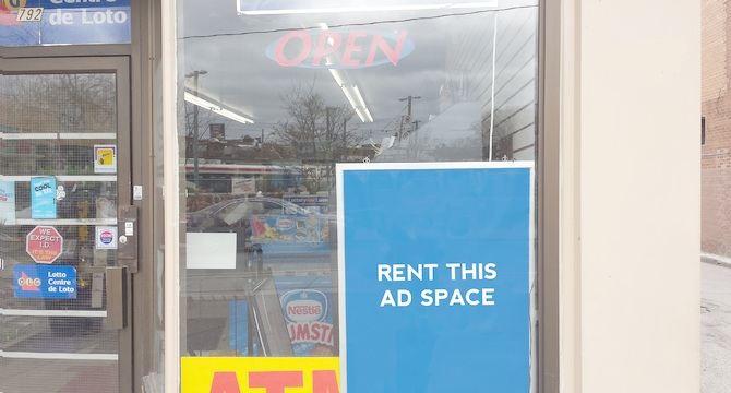 [Image: Ad space in front of a conveniece store]
