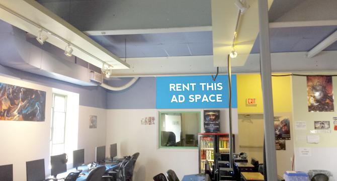 [Image: Indoor ad space in an internet cafe]