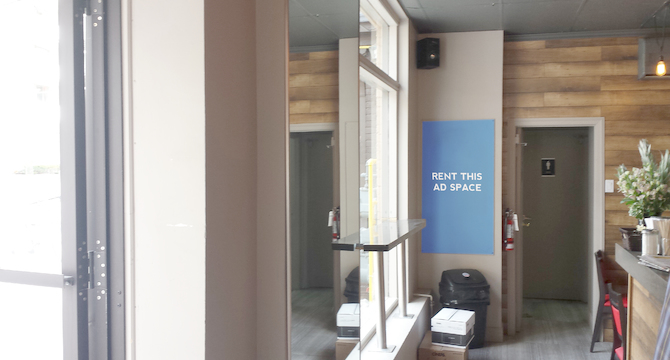 [Image: Indoor ad space in an espresso shop]